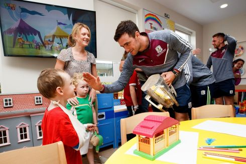 HOSPITAL VISIT: Galway hurling team captain David Burke with Martin Cummins (5) during a visit by team members to Our Lady's Children's Hospital in Crumlin, with the Liam MacCarthy Cup in tow, after their All-Ireland win over Waterford. Photograph: Bryan Keane/Inpho