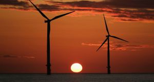 "The sun rising  beyond a wind farm. The restructuring of subsidies provides for a wide range of energy sources but is ""technology agnostic"", ie it does not favour one energy source over another. Photograph:  Getty Images"