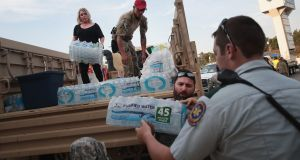 Volunteers unload a truck full of relief supplies after Hurricane Harvey. Photograph:  Scott Olson/Getty Images