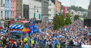 Waterford hurlers on board an open-topped bus are greeted by thousands of fans in the city on Monday evening. Photograph:  Patrick Browne