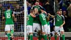 Northern Ireland's Jonny Evans celebrates scoring his team's first goal. Photograph: Reuters