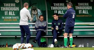 Manager Martin O'Neill and assistant manager Roy Keane with Seamus Coleman  at training. Photograph:  Ryan Byrne/Inpho