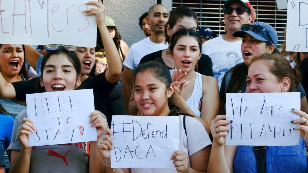 Supporters of the Deferred Action for Childhood Arrivals, or Daca, at a Labor Day rally in downtown Los Angeles on Monday. Photograph: Richard Vogel/AP