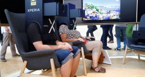 Visitors watch a Sony Xperia 4K HDR presentation at the IFA tech fair in Berlin. Photograph: Fabrizio Bensch/Reuters