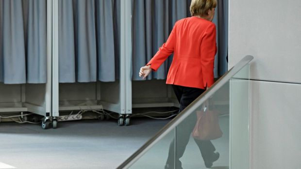Merkel leaves the plenum during a session of the German Bundestag in Berlin,. Photograph: Clemens Bilan/EPA