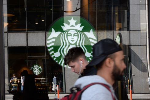 DOUBLE VISION: A Starbucks logo is reflected in another outlet's window on Westmoreland Street, in Dublin. Photograph: Dara Mac Donaill/The Irish Times
