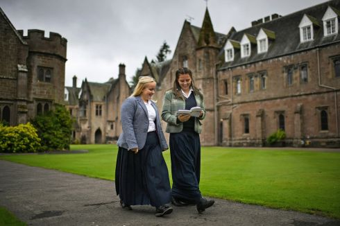 HISTORY GIRLS: Schoolgirls arrive at Scotland's Glenalmond College for the first day of term. For the first time in 170 years, girls will be boarding in the Gothic Front Quad of Glenalmond which has been until now a purely male preserve. Photograph: Jeff J Mitchell/Getty Images