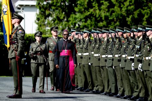 UNDER INSPECTION: HE Archbishop Jude Thaddeus Okolo, Titular Archbishop of Novica, Apostolic Nuncio of the Holy See inspecting the Guard of Honour by the 1st Infantry Battalion, Dún Uí Mhaoisíosa, Renmore, Galway, under the command of Lieut Catherine Smyth after presenting his credentials at the ceremony at Áras an Uachtaráin. Photograph: Maxwell's