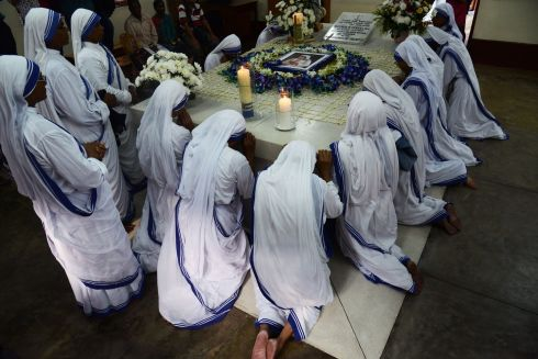 MOTHER TERESA: Roman Catholic nuns of the Missionaries of Charity pray at the tomb of Mother Teresa at a service to commemorate the 20th anniversary of her death at the order's house in Calcutta. Photograph: Dibyangshu Sarkar/AFP/Getty Images