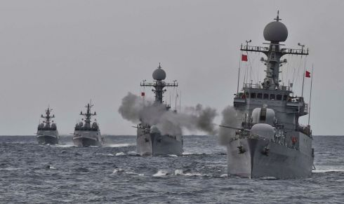 READY FOR BATTLE: South Korea's naval ships take part in a military drill for possible attack from North Korea in the water of the East Sea. Photograph: Republic of Korea Navy/Yonhap via Reuters