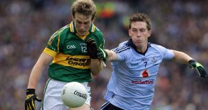 Kevin Nolan in action against Kerry's Donnchadh Walsh in the 2011 All-Ireland final in which Nolan won the man-of-the-match award. Photograph: Donall Farmer/Inpho