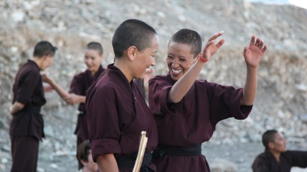 Buddhist nuns share a joke during a self-defence workshop in India's remote Himalayan region of Ladakh. Photograph: Nita Bhalla/Thomson Reuters Foundation