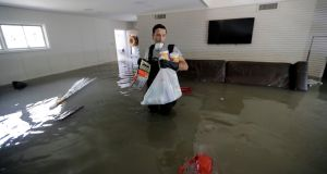 Gaston Kirby walks through floodwater inside his home near the Addicks and Barker reservoirs in Houston, in the aftermath of Hurricane Harvey. Photograph: David J Phillip/AP Photo