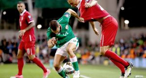Wes Hoolahan tries to hold off Nemanja Matic during Ireland's narrow defeat to Serbia. Photograph: James Crombie/Inpho