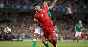 Ireland's David Meyler in action against Serbia's  Aleksandar Mitrovic during the World cup qualifier at the Aviva Stadium. Photograph:  James Crombie/Inpho
