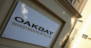 A logo of Oakbay Investments is seen at the entrance of their offices in Sandton, outside Johannesburg, South Africa. Photograph: Reuters/Siphiwe Sibeko