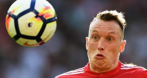 Manchester United have withdrawn their appeal against Phil Jones' two-match European suspension. Photograph: Michael Regan/Getty