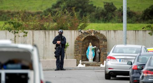 HOLlYHILL: Gardaí at the scene of a search of a housing estate in Hollyhill, Cork city, during a crackdown on criminality in the city. Photograph: Michael Mac Sweeney/Provision
