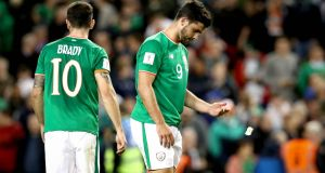 A dejected Robbie Brady and Shane Long following the defeat to Serbia at the Aviva Stadium. Photograph: Ryan Byrne/Inpho
