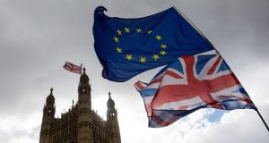 A Union Jack and an EU flag fly outside the Houses of Parliament in London, Britain. File photograph: Simon Dawson/Bloomberg
