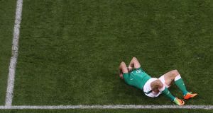 Shane Long on the floor during Ireland's qualifier defeat to Serbia. Photograph: Tommy Dickson/Inpho