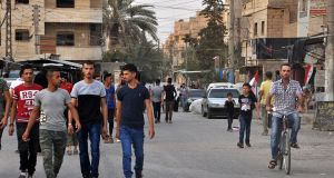 Syrians walk in the street in Deir al-Zor after Syria's army broke a years-long Islamic State siege on the government enclave. Photograph: Stringer/AFP/Getty Images