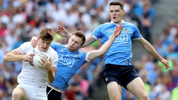 Dublin's Brian Fenton and Jack McCaffrey with Kildare's Kevin Feely. Photograph: Inpho