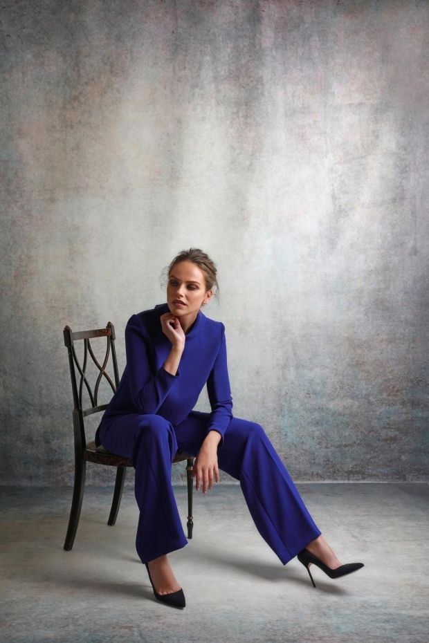 Davina – sapphire crepe top €450 with Rachel sapphire trousers €495 by Louise Kennedy