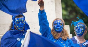 Protesters wearing European Union flag masks take part in an anti-Brexit demonstration outside the Houses of Parliament in Westminster. Photograph: Victoria Jones/PA Wire