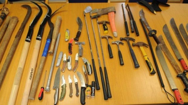 Slash hooks, machetes and knives which were recovered during a search of the St Anthony's Park Halting Site in Hollyhill. Photograph: An Garda