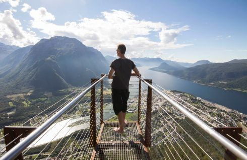 Photographer William Hederman on the Rampestreken viewing platform over Andalsnes, Norway. The photographer travelled up Norway's Atlantic coast to the spectacular Lofoten Islands in the Arctic Circle for the Irish Times Saturday magazine - see article. All Photographs: William Hederman