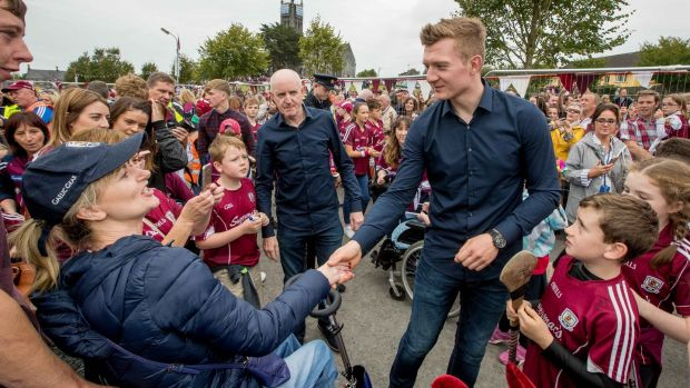 Supporters greet their hero Joe Canning. He has quipped that at least now the lack of an All-Ireland medal won't be used as a stick to beat him with. Photograph: Morgan Treacy/Inpho