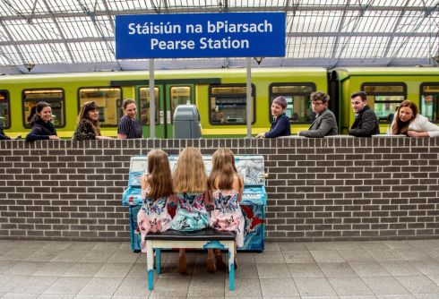 MAKE TRACKS: Aela O'Sullivan (10) and her twin sisters Siún and Eavan (9) are the first to play the newly-installed piano at Pearse Station in Dublin. Photograph: Brenda Fitzsimons/The Irish Times
