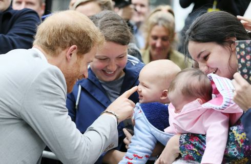 ROYAL VISIT: Prince Harry meets Emma Mason and her seven-month-old son Henry in St Anne's Square, Belfast, during the prince's visit to Northern Ireland. Photograph: Brian Lawless/PA Wire