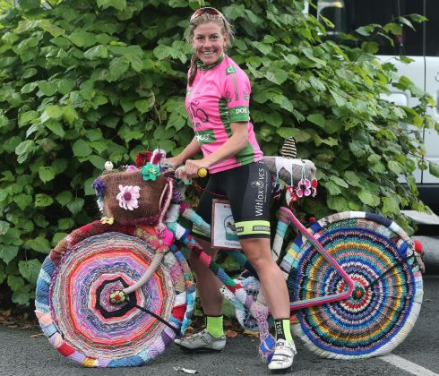 WOOL CYCLE: Race leader Belle de Gast admires a bicycle knitted by Castlecomer Knitting Group after Thursday's stage of the An Post Rás na mBan in Co Kilkenny. Photograph: Lorraine O'Sullivan