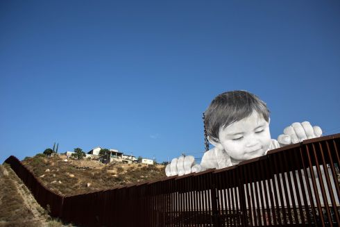 ARTISTIC VIEW: A view of an artwork by French artist JR on the US-Mexico border, in Tecate, California. Photograph: Guillermo Arias/AFP/Getty Images