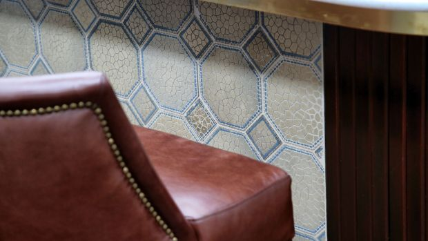 Tilework in the Harland Bar, Titanic Hotel Belfast. Many of the tiles in the building are originals, salvaged from the Harland & Wolff headquarters and drawing rooms. Photograph: Press Eye/Darren Kidd