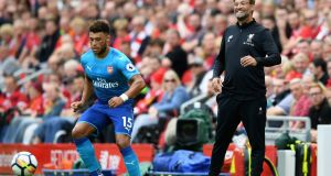 Alex Oxlade-Chamberlain: Played against Liverpool at Anfield before signing for the Merseysiders less than a week later: Photograph: Michael Regan/Getty
