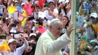 Pope Francis waves to the crowd from the popemobile as he arrives at Bolivar Square in Bogota, Colombia. Photograph: Luis Eduardo Noriega/EPA