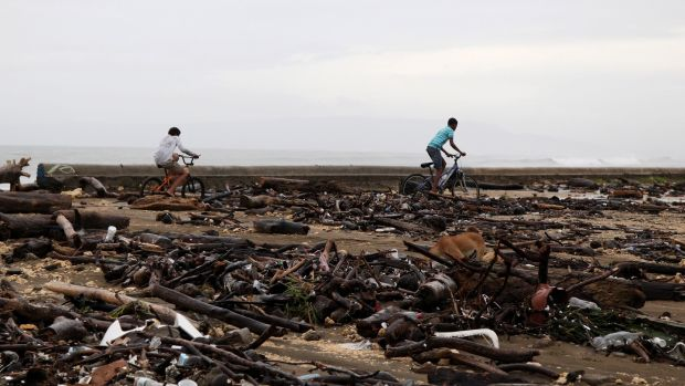 Locals ride their bikes among debris on a beach as Hurricane Irma moves off the northern coast of the Dominican Republic, in Nagua, Dominican Republic, September 7, 2017. Photograph: Reuters/Ricardo Rojas