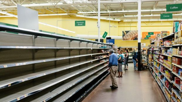 Empty bread shelves at a Walmart in Port St. Lucie in Florida on Thursday. Photograph: Jason Henry/The New York Times