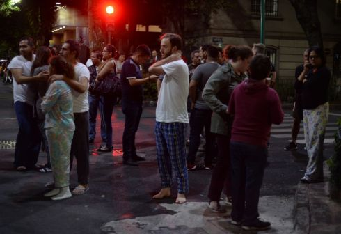 People gather on a street in Mexico City during the earthquake. Photograph: Luis Perez/AFP/Getty Images