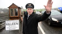 John McNamee, dressed as a customs worker, joins other members of Border Communities Against Brexit in setting up an old customs post at Carrickcarnon, between Dundalk and Newry. Photograph: Dara Mac Dónaill
