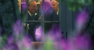 US Senate minority leader Chuck Schumer  makes a point to president Donald Trump in the Oval Office prior to Trump's departure for North Dakota to deliver a speech on tax reform. Photograph: Alex Wong/Getty Images