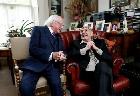 SAOI CHANGE: President Michael D Higgins confers the torc, the symbol of the office of Saoi of Aosdána, on dramatist Tom Murphy at his home in Dublin. Photograph: Maxwellphotography.ie