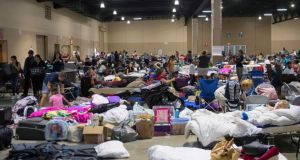 Hundreds of people gather in an emergency shelter at the Miami-Dade County Fair Expo Center in Miami, Florida, September 8th, 2017, ahead of Hurricane Irma. Photograph: Saul Loeb/AFP/Getty Images