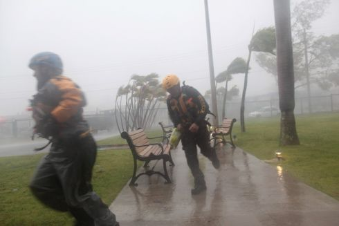 Members of the civil defense run as Hurricane Irma howls past Puerto Rico after thrashing several smaller Caribbean islands, in Fajardo, Puerto Rico.  Photograph: Alvin Baez / Reuters
