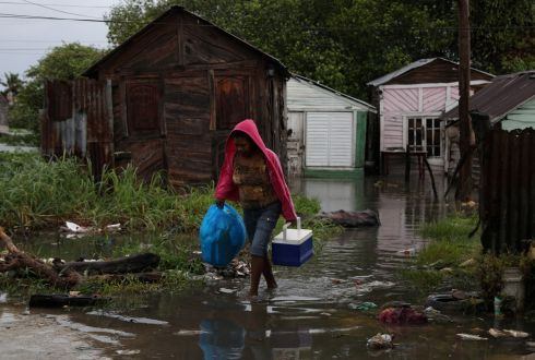 A woman walks through a flooded path as Hurricane Irma moves off from the northern coast of the Dominican Republic, in Nagua. Photograph: Ricardo Rojas/Reuters