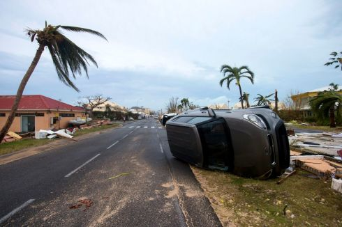 A car turned onto its side in Marigot, in the French Collectivity of St Martin, after the passage of Hurricane Irma. Photograph: Lionel Chamoiseau/AFP/Getty Images