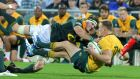 South Africa's Jaco Kriel dumps Australia's  Reece Hodge. Photograph: Richard Wainwight/Reuters